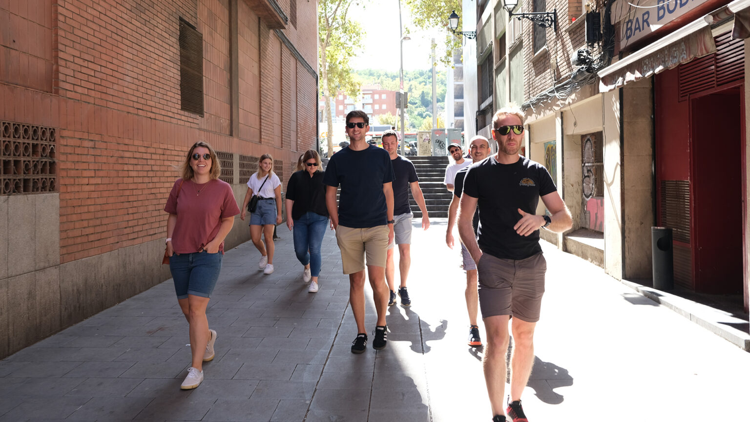 The Canopy Studio team walking down a street in Barcelona