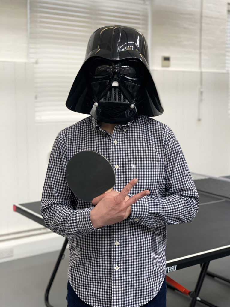 George flood posing with joke mask on